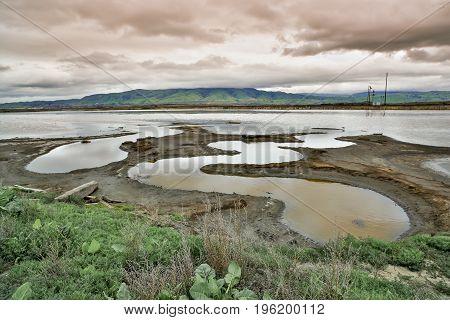 Alviso Slough and Diablo Mountain Range in Winter. Alviso Marina County Park, Santa Clara County, California, USA.