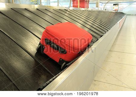 Baggage luggage suitcase on conveyor belt at the airport