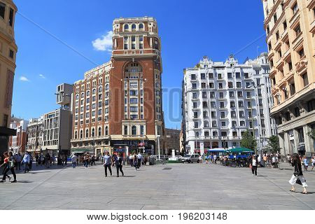 MADRID, SPAIN - MAY 24, 2017: Plaza del Callao is located in the center of the main street of the city - Gran Via.