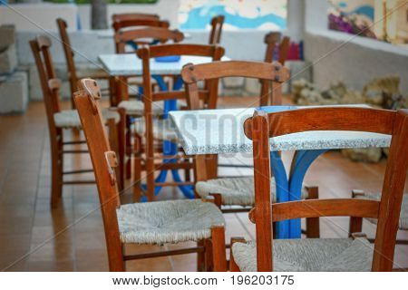 The Interior Of The Cafe Chairs And Table