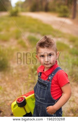 A boy with a toy in his hands