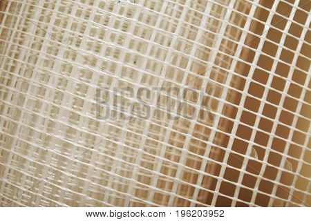 closeup of a fiber glass mesh insulation net