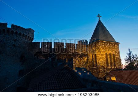 Church tower inside Kalemegdan fortress walls at blue hour in Belgrade, Serbia