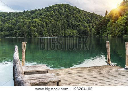 Pier on the lake. Plitvice Lakes in the evening. National Park Plitvice Lakes, Croatia.