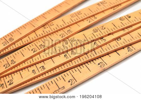 detail of a carpenter's inch ruler over white