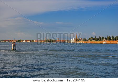 Panoramic view of Venice lagoon with buildings on the horizon, at the sunset in the city center of Venice, the historic and amazing marine city. Located in the Veneto region, northern Italy