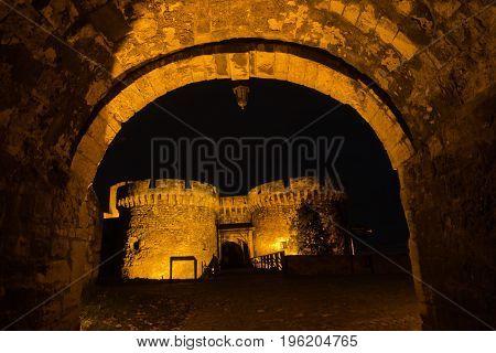 Kalemegdan fortress gates and towers at night in Belgrade, Serbia