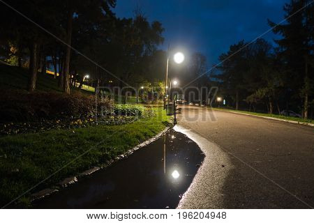 Walking path after rain at blue hour, Kalemegdan park in Belgrade, Serbia
