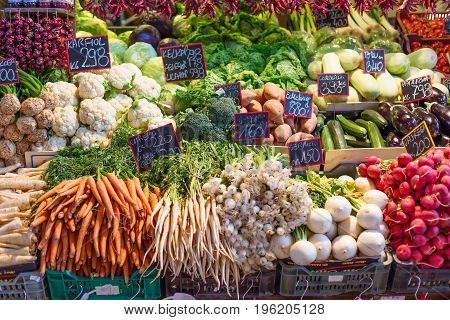 Fresh vegetables at the central market in Budapest Hungary. Carrots cabbage cole broccoli radish herbs eggplant
