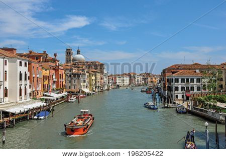 Venice, Italy - May 09, 2013. View of the Grand Canal with boats and buildings on the bank, at the city center of Venice, the historic and amazing marine city. Located in Veneto region, northern Italy