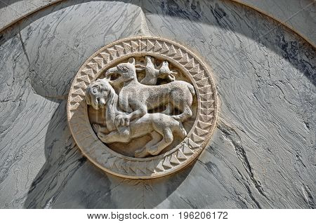 Close-up of embossed marble sculpture of animals on facade of old building in the city center of Venice, the historic and amazing marine city. Located in Veneto region, northern Italy