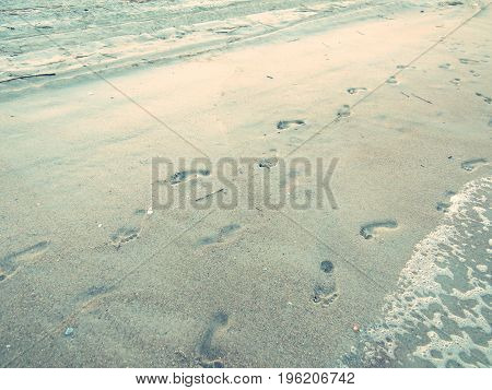Footprints in the sand on an ocean shoreline in Florida