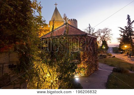 Churches and towers of Kalemegdan fortress at twilight in Belgrade, Serbia