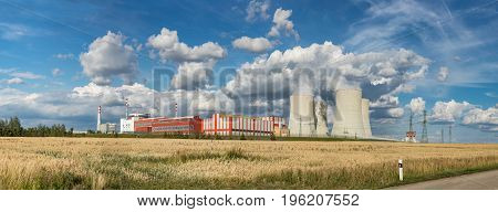 Panoramatic view on Nuclear power plant Temelin in the Czech Republic. Operating buildings and control rooms. Clouds of steam derailing from a nuclear power station tower.