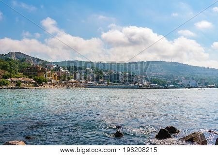 View from the sea to the city balchik cityscape houses and apartment buildings on the shore and hills in black sea coast Bulgaria.