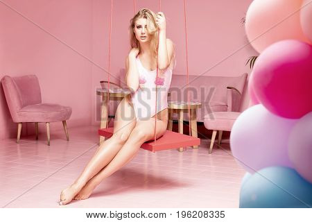 Young Fashionable Girl In Pink Interior.