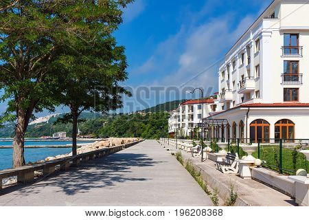 Balchik cityscape view of city quay with apartment buildings and houses on the hills of black sea coast in Bulgaria.