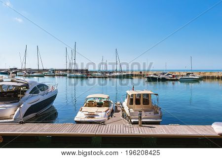 Yachts sailing boats and pleasure boats are moored in marina of Balchik city in black sea coast at Bulgaria.