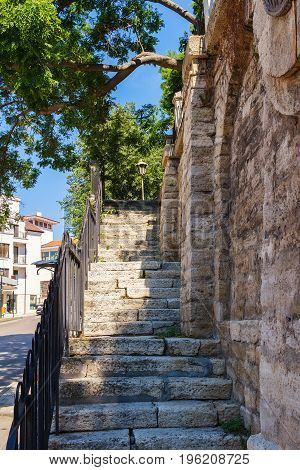 Old stone stairs leading up to the park in Balchik town Bulgaria.