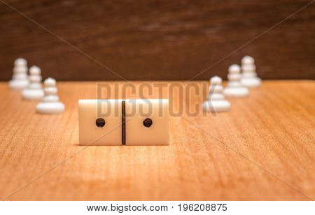 Popular board games around the world on a wooden background are chess and dominoes all like to play in them and in our time