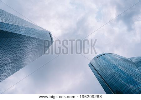 Madrid Spain - June 25 2017: Low angle view of skyscraper in Cuatro Torres Business Area CTBA Four Towers Business Area a business district in Madrid against sky