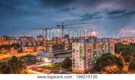 Lightnings Over Housing Estate. Storm in the City.