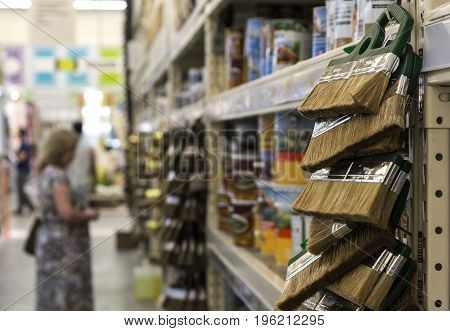A woman stands near the division of paints and varnishes
