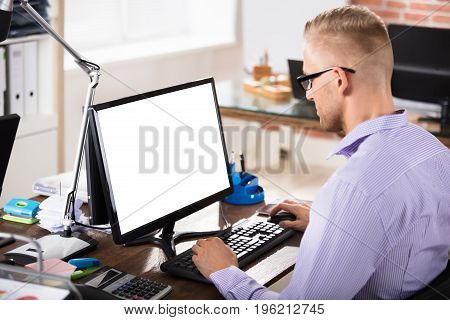 Businesswoman Working On Blank White Screen Computer In Office