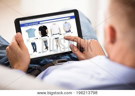 Close-up Of A Man Doing Online Shopping On Digital Tablet