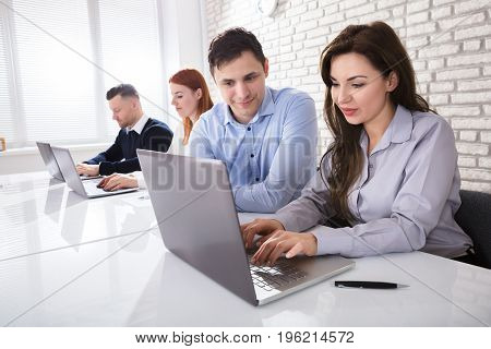 Businessman Working With His Colleagues At Workplace In Office