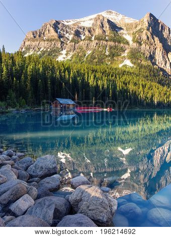 Turquoise Lake Louise and the Boathouse with Canoes, Banff National Park, Canada