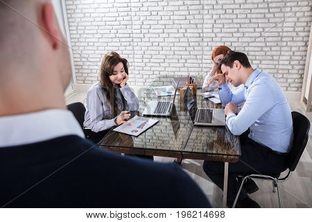 Young Boredom Coworkers At Workplace In Business Meeting