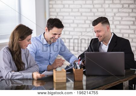 Group Of Businesspeople Working Together In Office