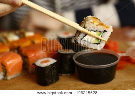 sushi roll california with soy souce close up photo