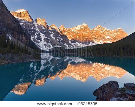 Stunning Orange and Blue Moraine Lake at Sunrise