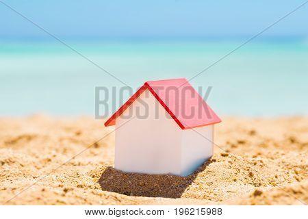 Single House Model On Sand At Beach