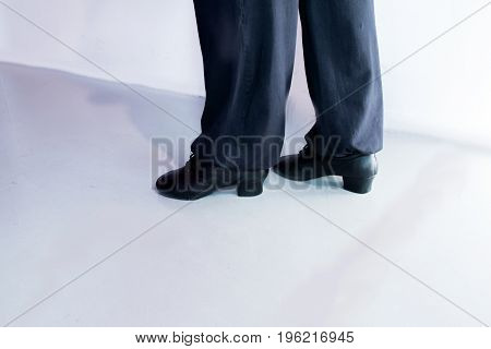 Man dancing with black salsa sandals in a night club