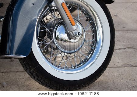 Wheel on a sport motobike as a background