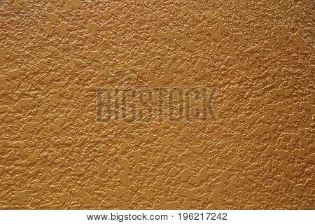 Decorative plaster wall isolated ochre  dark yellow texture