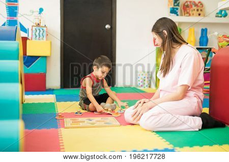 Boy Playing In A Therapy Center