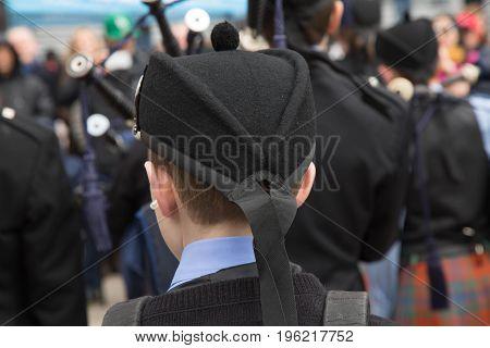 Closeup young musician bagpipe traditional irish hat