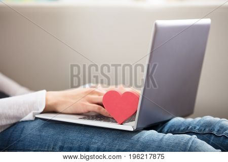 Heart Shape On Laptop Over The Woman's Lap