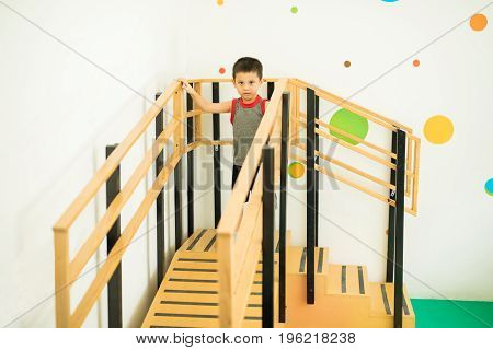 Boy Walking On Stairs And A Ramp