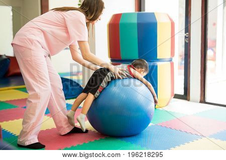 Therapist Helping A Boy Relax
