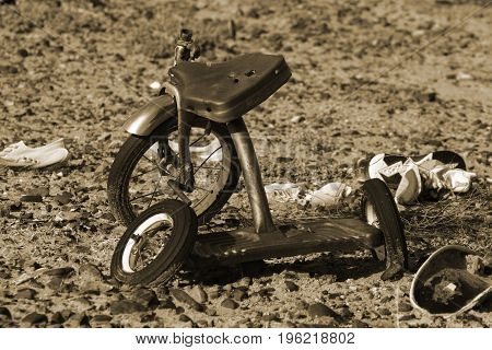 Vintage bike used as target practice laying in its final resting place