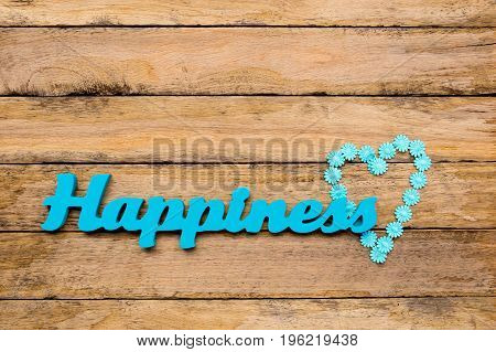 Happiness - Blue Turquoise Wooden Word With Heart Shape Daisy Ribbon On Wooden Background
