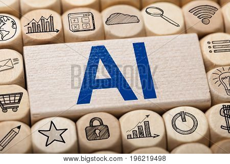 Full frame shot of AI text on wooden block surrounded by various computer icons