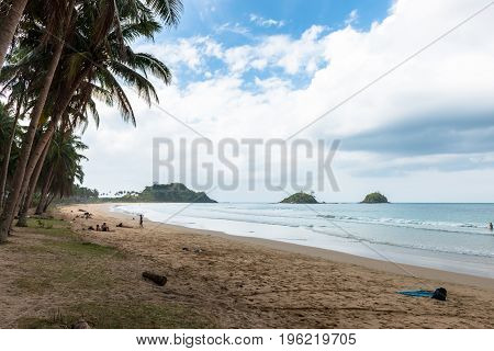 EL NIDO PALAWAN PHILIPPINES - JANUARY 20 2017: Horizontal picture of Nacpan Beach with a blue sky clouds and tourists.