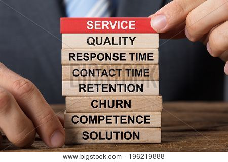 Closeup of businessman building service concept with wooden blocks on wood