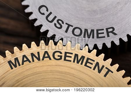 Closeup of customer management concept on interlocked cogwheels